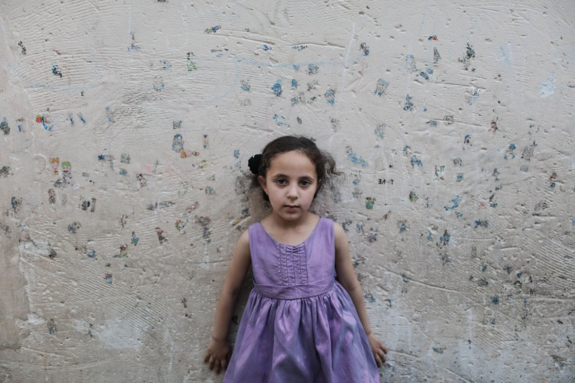 Tala Abusharikh, aged six, who lives in the Jabalia refugee camp, says she wants to return to her home village that was occupied by Israel. [Wissam Nassar/Al Jazeera]