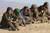 Kurdish YPG fighters gather after taking control of an area from ISIL militants in Hasaka province, Syria, in November 2015. [Reuters]