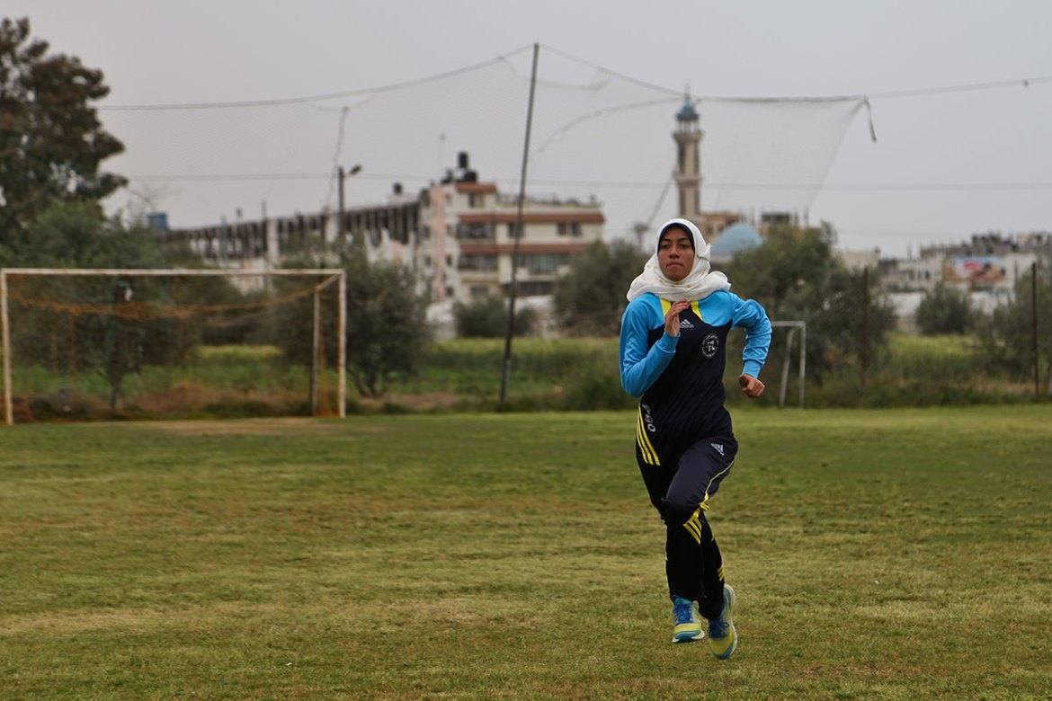 Nofal started running inside a secluded football field, but became bored from running laps and decided to explore the streets. [Lena Odgaard/Al Jazeera]