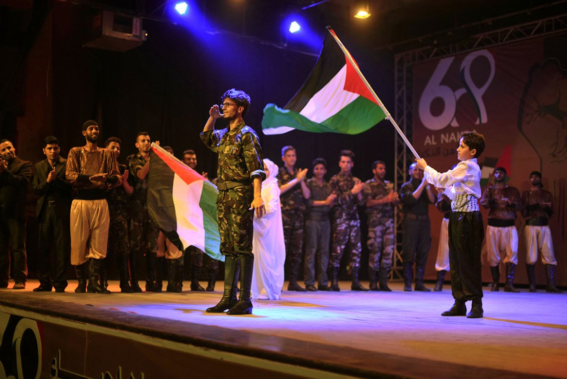 Hundreds of Palestinians attend an event commemorating the 68th anniversary the Nakba. Performers sang and danced the traditional dabka. [Wissam Nassar/Al Jazeera]