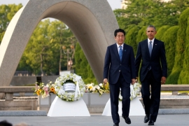 Obama and Abe laid wreaths at Hiroshima Peace Memorial Park on Friday [Carlos Barria/Reuters]