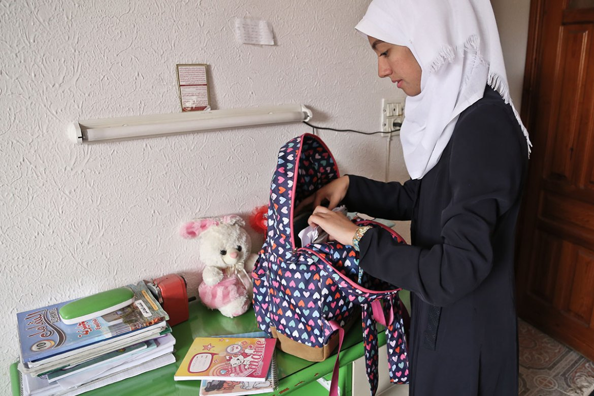 Nofal goes to school in the afternoon, which enables her to run in the morning. As the number of students in Gaza far exceeds the capacity of the schools, most schools run in shifts. [Lena Odgaard/Al Jazeera]