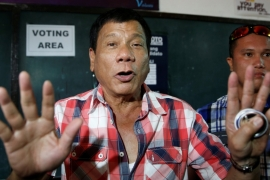 Rodrigo 'Digong' Duterte talks to the media before casting his vote [Erik De Castro/Reuters]