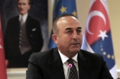 Turkish Foreign Minister Mevlut Cavusoglu speaks during a news conference on May 4, as the EU Commission recommended to grant Turkish citizens the right to travel to Europe without visas. [AP]