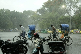Heavy downpours break the heat in Bangladesh, but also bring deadly thunderstorms [Abir Abdullah/EPA]