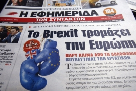 A Greek daily newspaper with the headline 'Brexit Scares Europe' in reference to the referendum [Milos Bicanski/Getty Images]