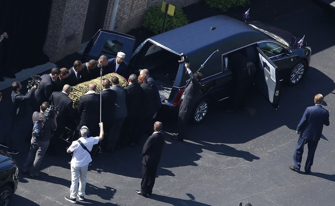The casket bearing the remains of Muhammad Ali is loaded into a hearse during the funeral procession. [Adrees Latif/Reuters]