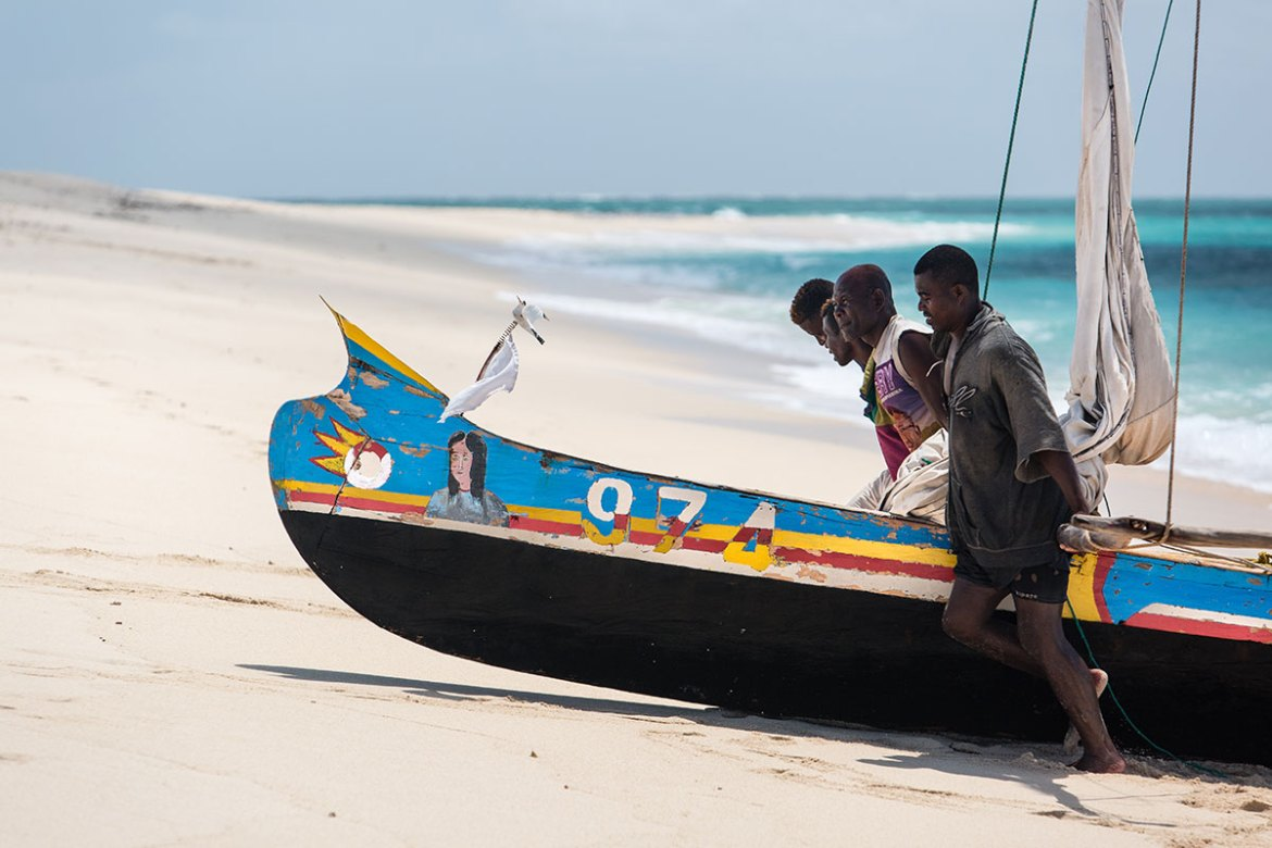 In a timeless custom, fishermen help each other to pull a sailing canoe up from the surf on to the sandbar they are inhabiting. In the remote islands, there is a strong sense of community among the fishermen. The government of Madagascar and Blue Ventures, a marine conservation NGO, are working with traditional fishermen to create a community-managed marine protected area. By giving small-scale fishermen strong management rights, they hope fisheries will recover and even become profitable again. [Garth Cripps/Al Jazeera]