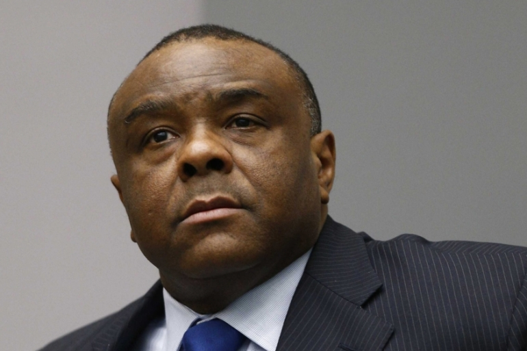 Former Congo Vice President Jean-Pierre Bemba sits in the courtroom of the International Criminal Court [EPA]