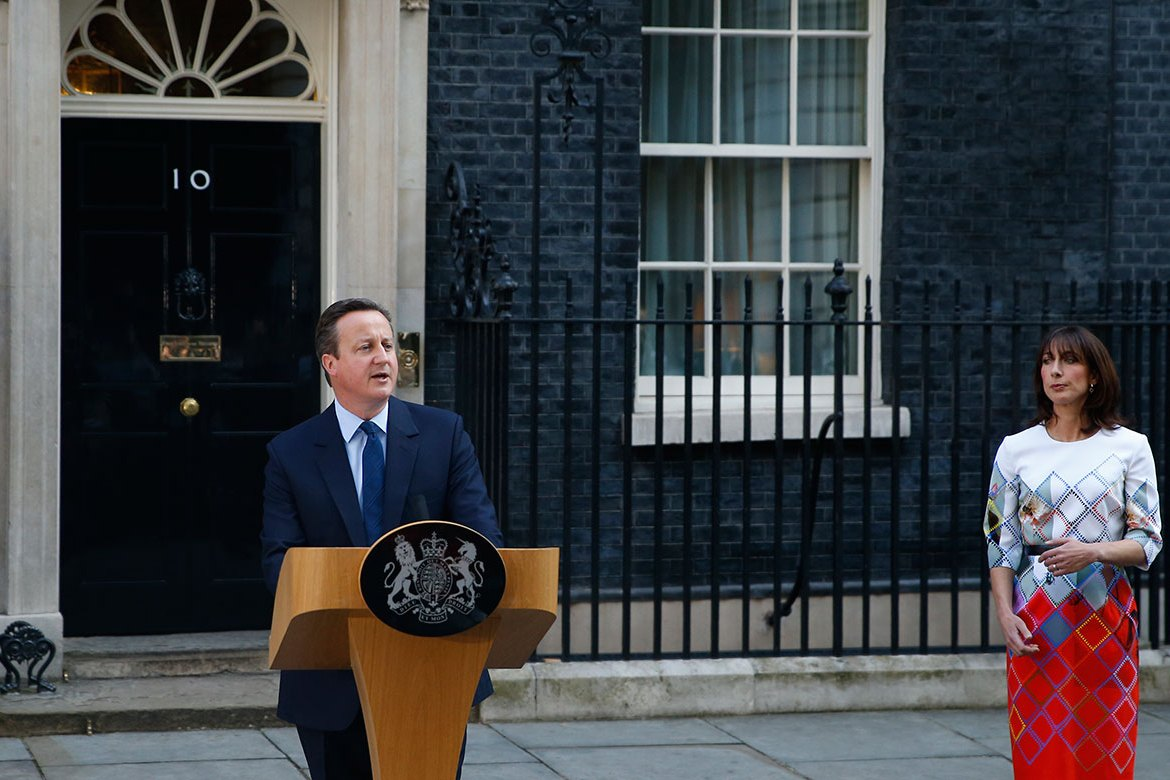 Britain's Prime Minister David Cameron, accompanied by his wife, Samantha, speaks to the media in front of 10 Downing Street, London, as he announces he will resign by the time of the Conservative Party conference in the autumn. His decision follows the EU referendum, in which Britain voted to leave the EU. [Alastair Grant/AP]