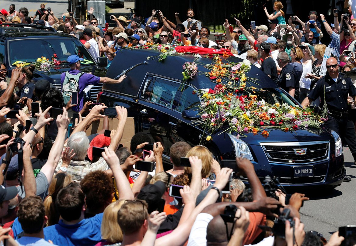 The hearse carrying Ali's body enters Cave Hill Cemetery, Louisville, Kentucky. [John Sommers II/Reuters]