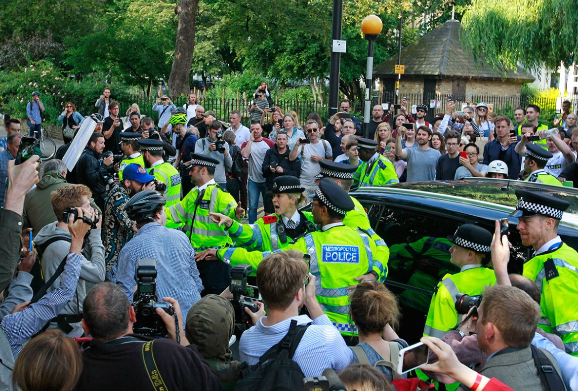People gather round the car of British MP Boris Johnson as he leaves his home in London. [Tim Ireland/AP]