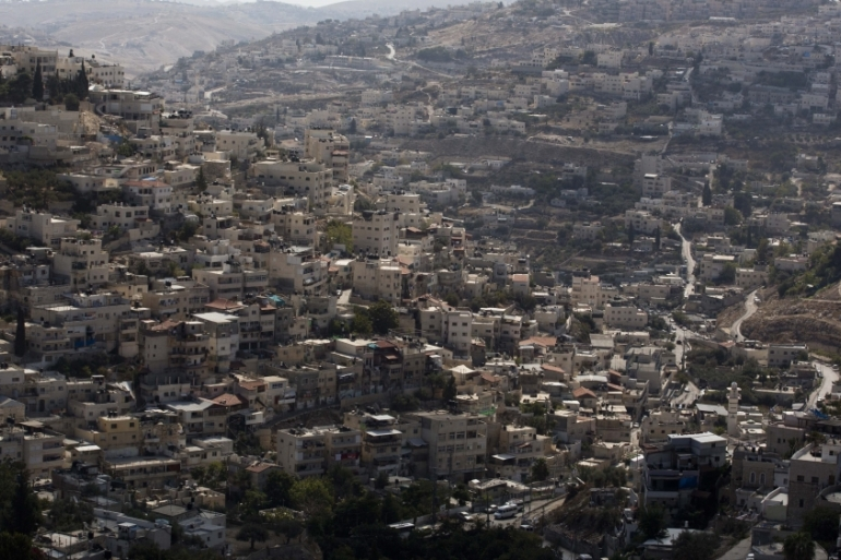Silwan neighbourhood is a flashpoint in the struggle between ideologically driven Israelis and longtime Palestinian residents [EPA]