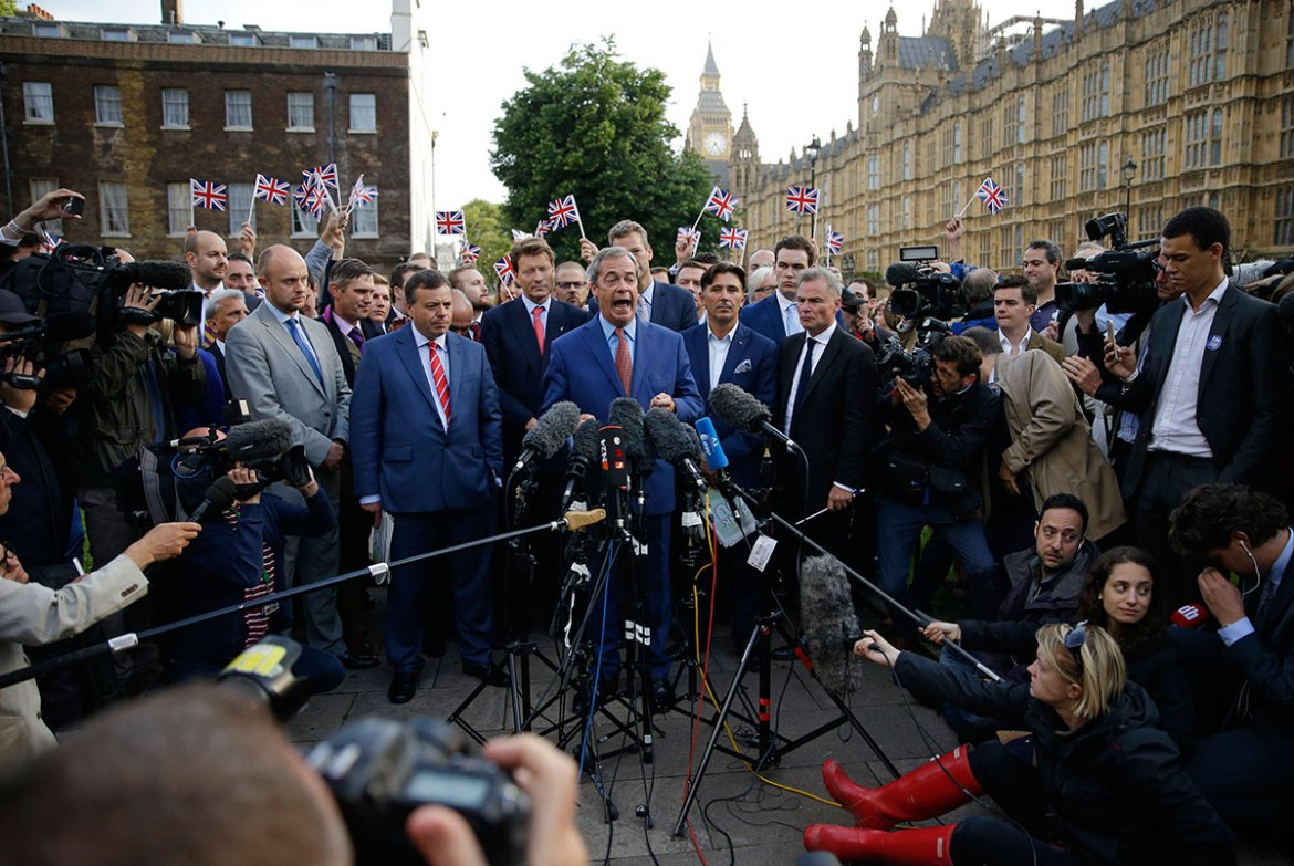 Nigel Farage, the leader of the UK Independence Party, speaks to the media on College Green in front of the Houses of Parliament in London. Britain voted to leave the European Union after a bitterly divisive referendum campaign, according to tallies of official results on Friday. [Matt Dunham/AP]