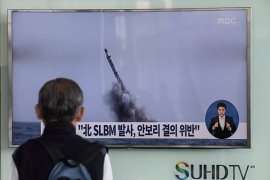 A man watches a TV news channel in Seoul showing footage of a North Korean missile launch on April 24 [AFP/Getty Images]