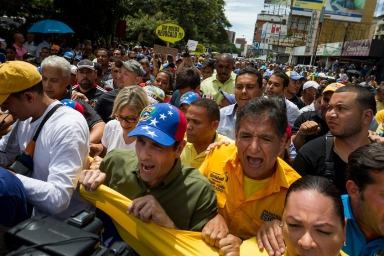 Opposition leader Henrique Capriles says the only way to resolve Venezuela's crisis is through a recall vote [EPA]
