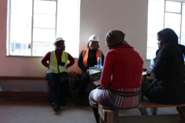 Mobilisers with the Mineworkers Development Agency register Seipati for a free health screening [Caelainn Hogan/Al Jazeera]