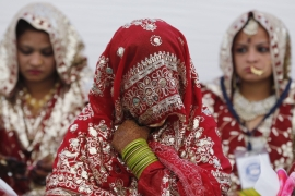Muslim brides wait for the start of a mass marriage ceremony in Ahmedabad, India, February 2016 [Reuters]