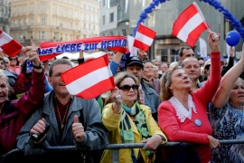 Austrian far-right Freedom Party supporters wave flags during the final election rally in Vienna on April 22 [Reuters]