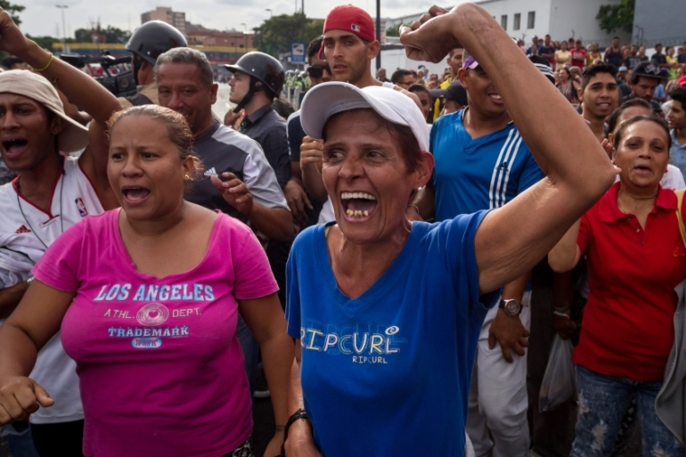 "With crowds chanting ""We want food!,"" protests and melees at shops have spread across Venezuela in recent weeks [Miguel Gutierrez/EPA]"