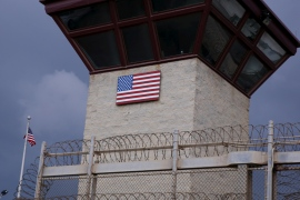 The United States flag decorates the side of a guard tower at Guantanamo Camp VI in Cuba [Lucas Jackson/[Reuters]