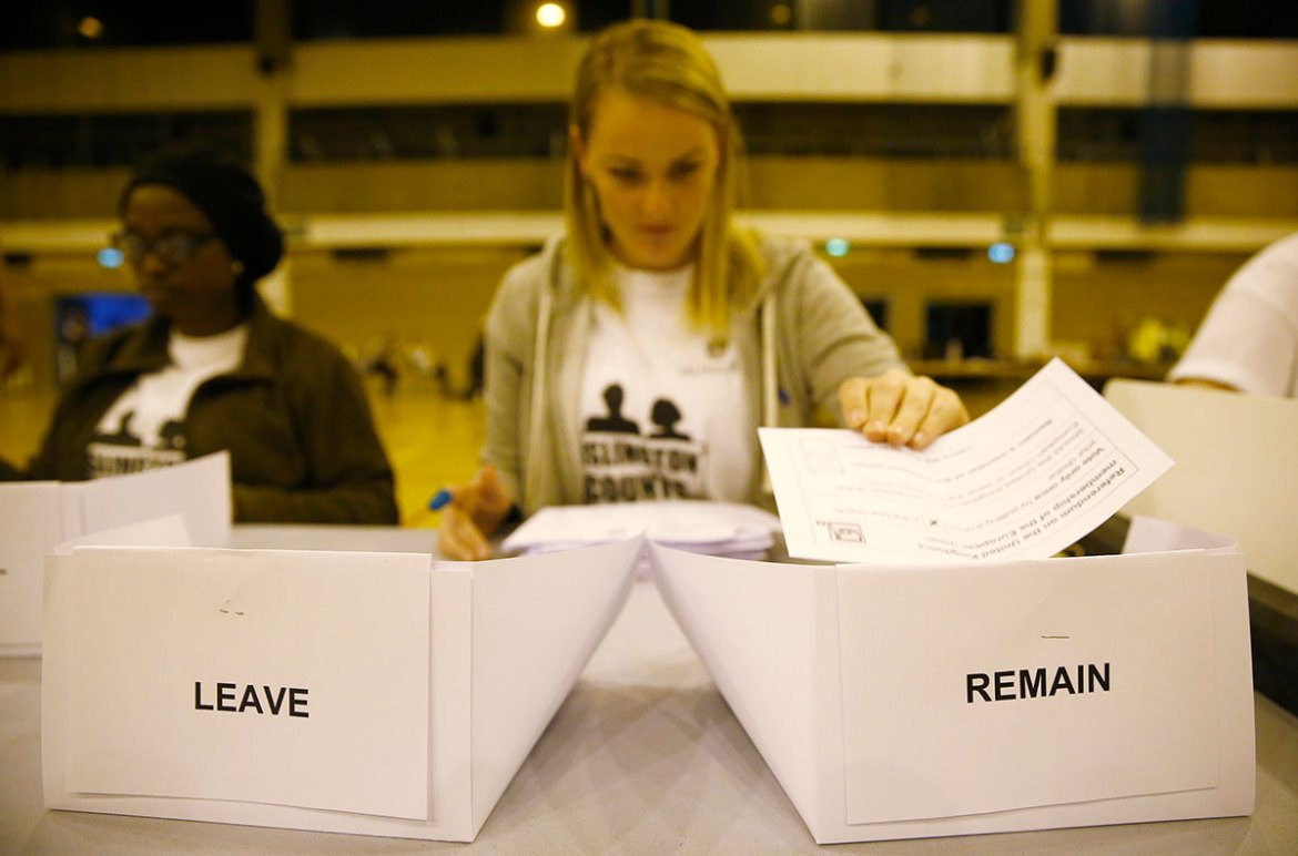 A worker counts ballots after polling stations closed in the Referendum on the European Union in Islington, London. [Neil Hall/Reuters]