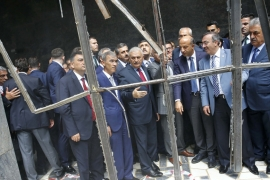 Turkey's Prime Minister Binali Yildirim, centre, visits damaged parts of the Turkish parliament in Ankara on July 19 [Reuters]