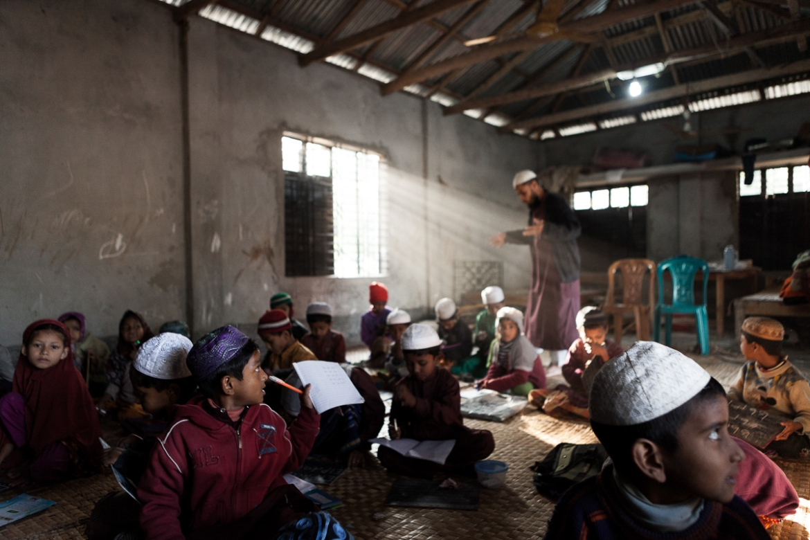 Pupils study in  a religious school in the town of Charfasson, on Bhola, where many children come from a nearby orphanage. Bhola has been hit by several deadly hurricanes and cyclones, leaving many children without parents. [Karim Mostafa/Al Jazeera]