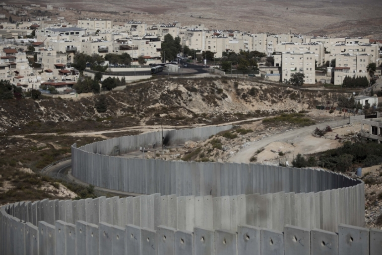 Building settlements on occupied land is considered illegal under international law [File:AP]