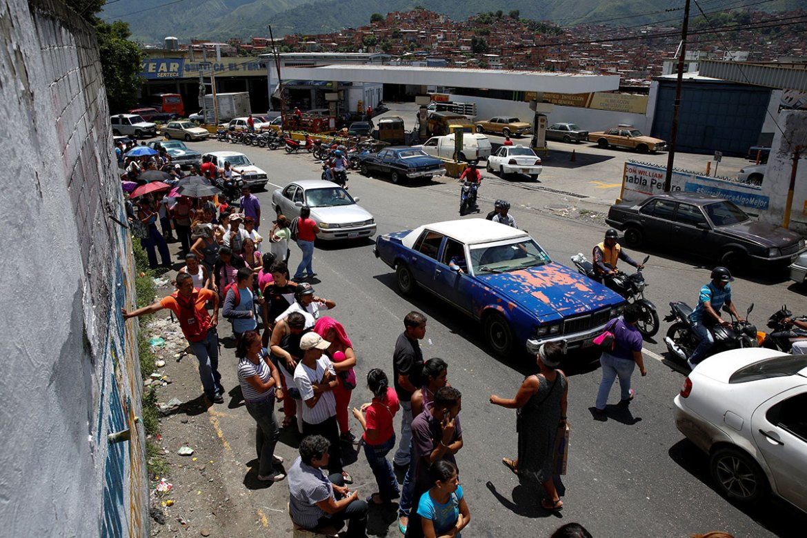More than 100,000 Venezuelans, some of whom drove through the night in caravans, crossed into Colombia over the weekend to hunt for food and medicine that are in short supply at home. [Carlos Garcia Rawlins/Reuters]