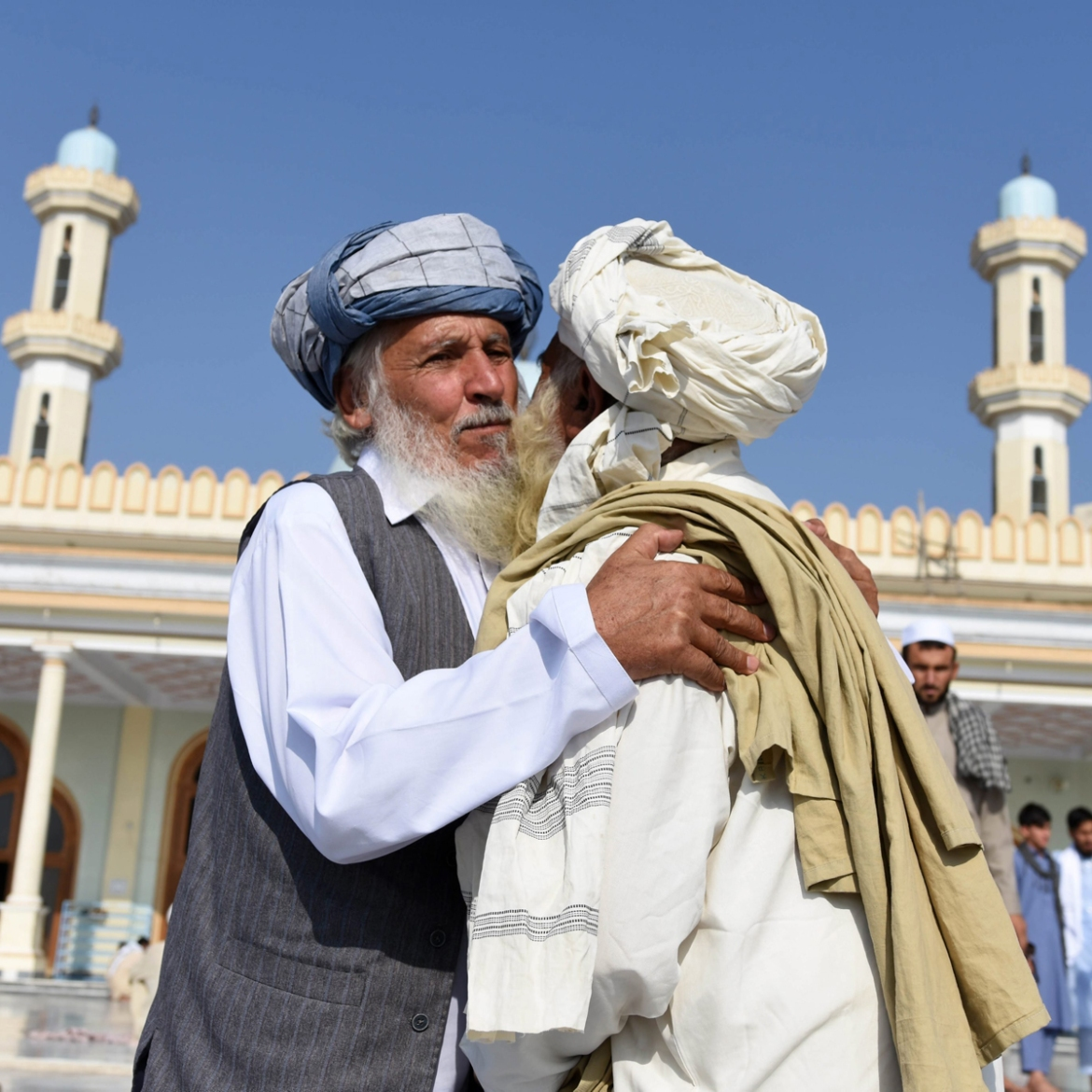 Men hug each other after Eid al-Fitr prayers in Behsood district of Nangarhar province, near Jalalabad, Afghanistan. [Ghulamullah Habibi/EPA]