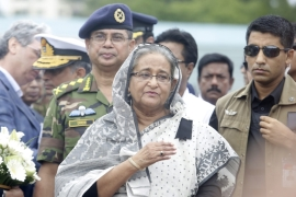 PM Hasina paid respects to the victims by visiting a stadium where their bodies were kept [Reuters]