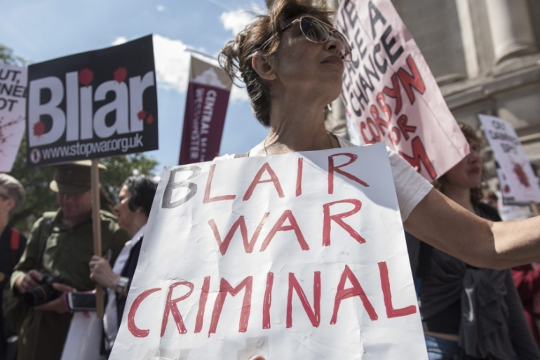 Protesters hold a demonstration as they wait for the release of the Chilcot Inquiry report in London, Britain [EPA]