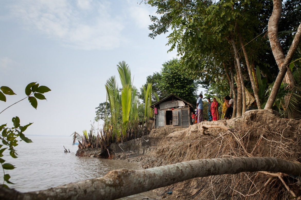 The small road that once led through Kanainagar has disappeared under water. Little by little, it crumbled into the river, along with a row of houses that stood on the shore. [Karim Mostafa/Al Jazeera]