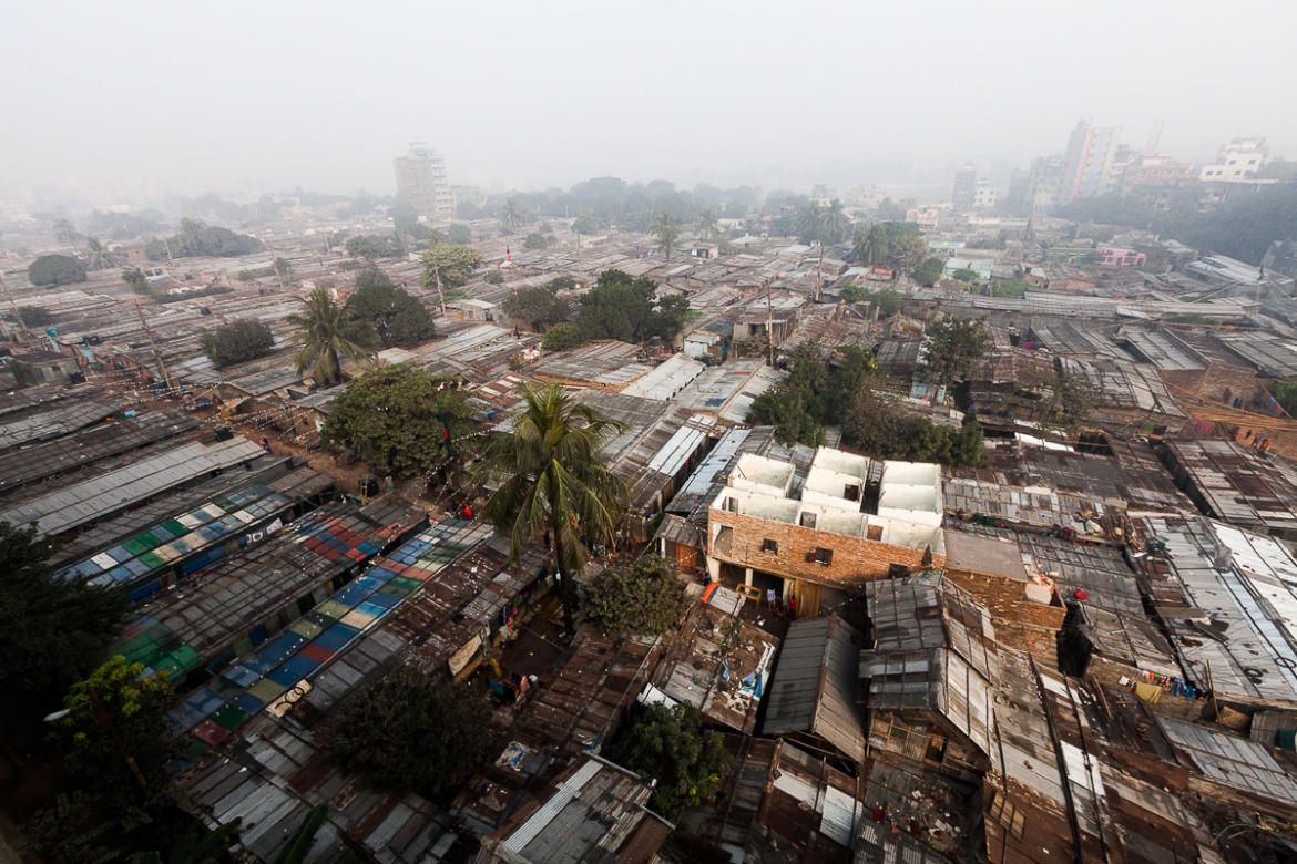 The large slum area of Bhola Bosti, in the northern part of Dhaka, was established 40 years ago by families who fled the island of Bhola after losing their lands. About 600 families live in Bhola Bosti today, and new people continue to arrive, mostly from the island. [Karim Mostafa/Al Jazeera]