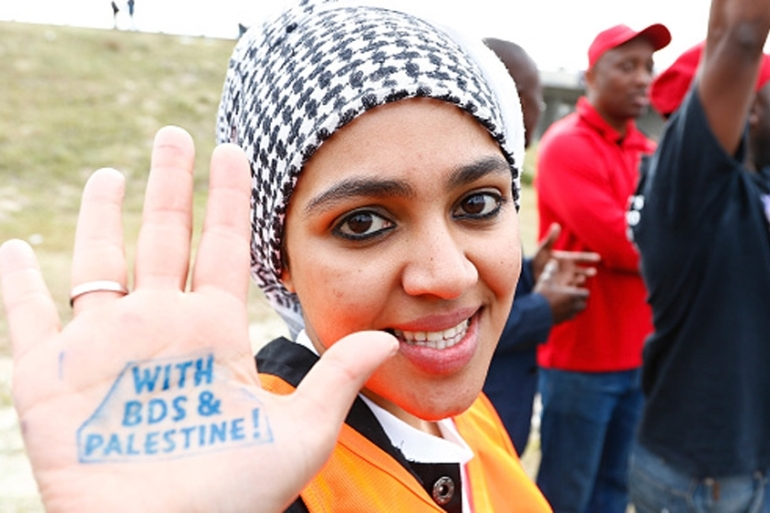 A pro-Palestinian protester supporting the BDS campaign against Israel takes part in a demonstration in Cape Town, South Africa [Getty]