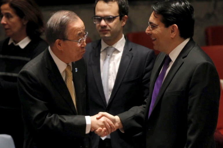 UN Secretary General Ban Ki-moon, centre, greets Israel's Ambassador to the UN Danny Danon, right, in New York, January 26 [Reuters]