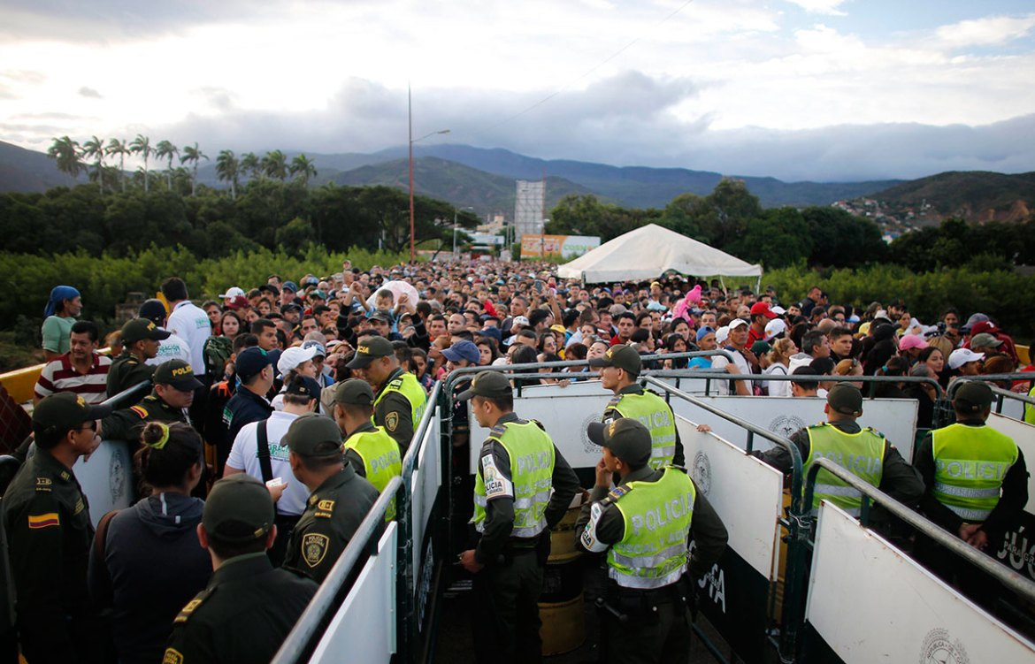 The border was heavily patrolled by Venezuelan troops. The crowds were mostly orderly amid an atmosphere of tense excitement [Ariana Cubillos/AP]