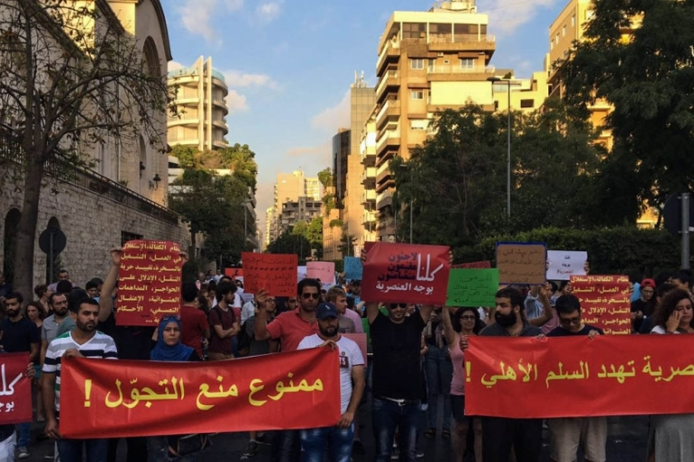 Slogans read: 'Curfews must be forbidden' and 'Racism threatens civil peace' [Kareem Chehayeb]