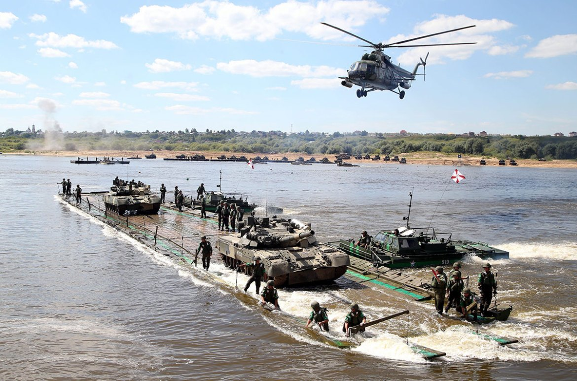 Russian soldiers take part in the Open Water competition for pontoon bridges, part of the International Army Games 2016 in the town of Murom, Russia. [Maxim Shipenkov/EPA]