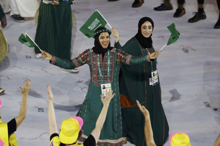 Attar, centre, participates in the opening ceremony at the Olympic Games in Rio last week [Stoyan Nenov/Reuters]