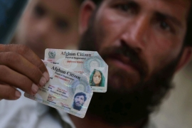 ID card says status is 'Afghan citizen temporarily residing in Pakistan' [Ghulamullah Habibi/EPA]