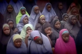 A still image from a video posted by Boko Haram on social media shows girls the group said are schoolgirls from Chibok [Reuters]