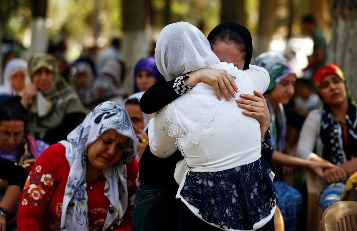 The bride and groom - a couple from the predominantly Kurdish region of Siirt in  southeast Turkey - were injured in the wedding attack, although their wounds were not serious. [Osman Orsal/Reuters]