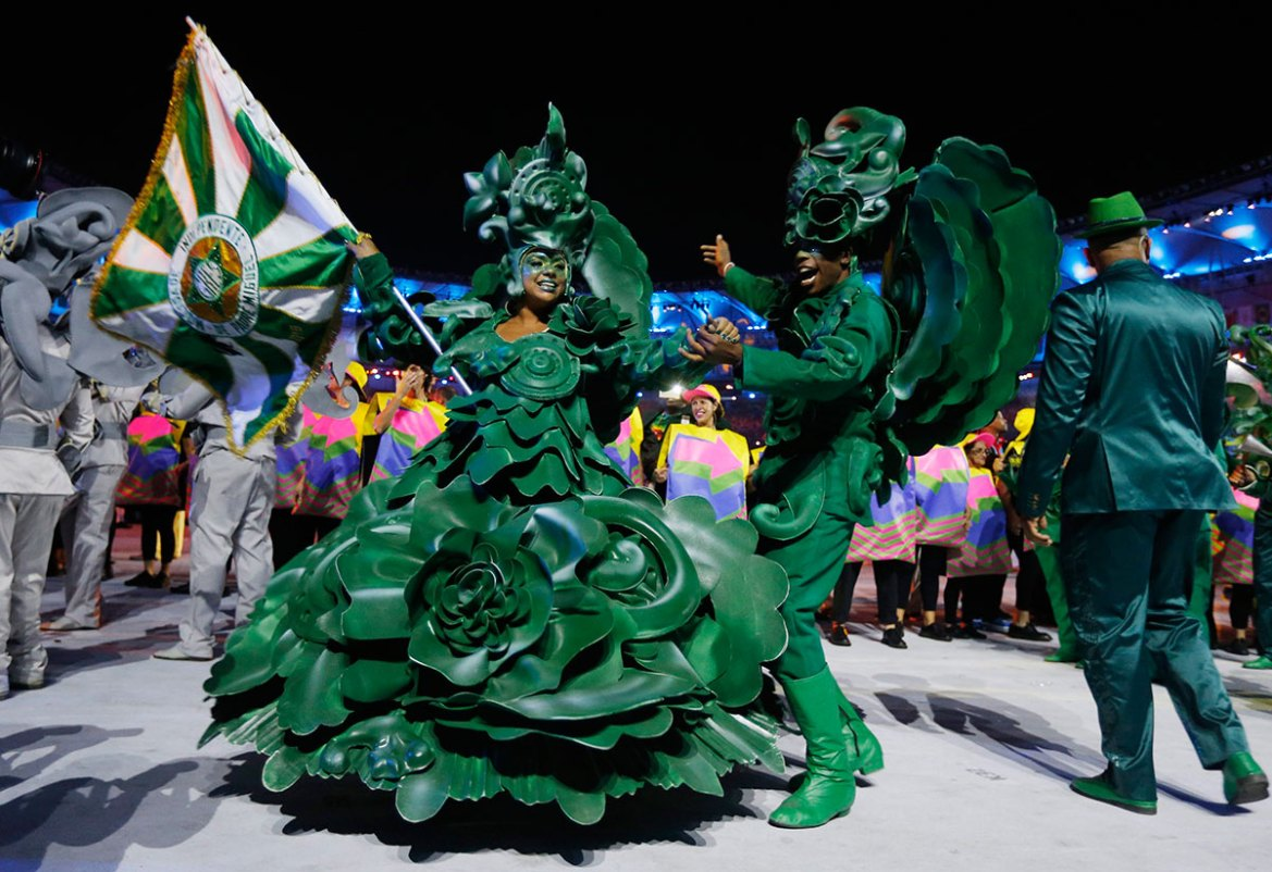 Members of a Samba school perform during the opening ceremony. [Sergei Ilnitsky/EPA]