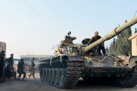 Battle for key military base rages in Syria's Aleppo