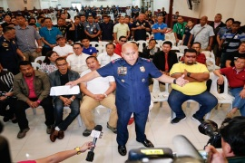 Some 27 mayors and 31 police officers surrendered in Manila on Monday in the hopes clearing their names [EPA]