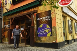 A man walks out of a casino in Prague's new town. It is one of many in the city [Philip Heijmans/Al Jazeera]
