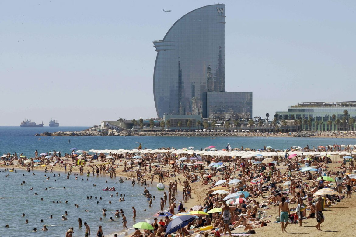 Temperatures are also rising in Spain, but Barcelona should keep its cooling breeze and avoid the worst of the heat [Andreu Dalmau/EPA]