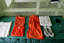 A uniform and other supplies that are given to detainees lie on a bed in a cell at Camp Delta at Guantanamo Naval Base in Guantanamo [Mark Wilson/Getty Images]